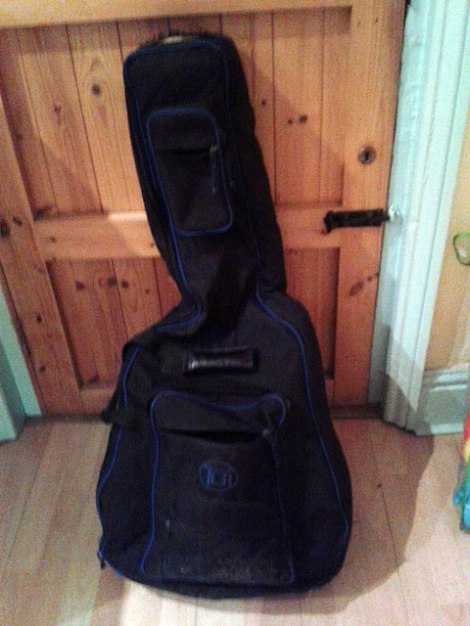 My guitar bag leaning against the door, just before we said goodbye for the last time