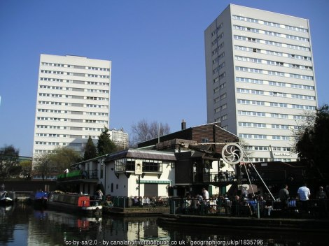 A view of the Flapper from across the canal with two tower blocks in the background